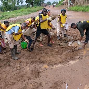Members of the Kpayama Branch doing road repair