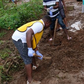 Members of Kpayama Branch digging a drain ditch